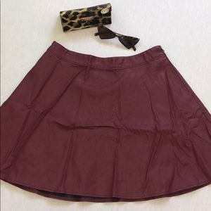 Maroon pleather skater skirt. With pockets. NEW!